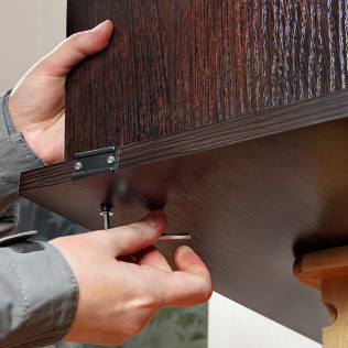 person fixing furniture